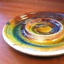 Flambeaux bread and oil plate featured at Mackerel Sky Gallery of Contemporary Craft